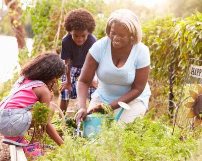 Woman Gardening with Grandchildren